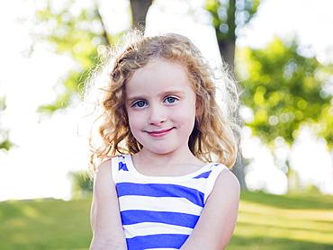 Portrait of blonde girl (4-5) outdoors, USA, Utah, Salt Lake City