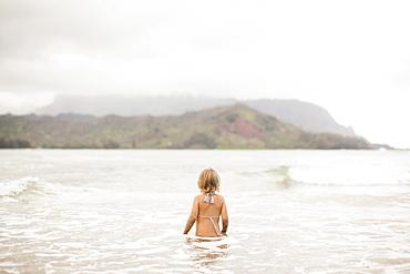 Baby girl (2-3) wading in ocean, Kauai, Hawaii