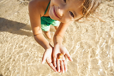 Girl (6-7) playing on beach, Kauai, Hawaii
