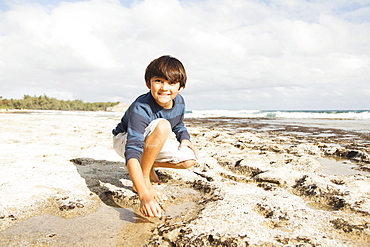 Boy (10-11) playing on beach, Kauai, Hawaii