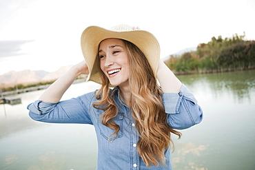Portrait of young woman wearing hat, Salt Lake City, Utah