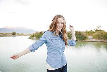 Portrait of young woman dancing player by lake, Salt Lake City, Utah