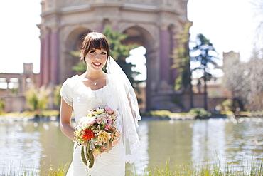 Portrait of young bride in park, San Francisco, California