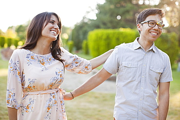 Couple hanging out in park, Salt Lake City, Utah
