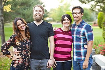 Portrait of group of friends in park, Salt Lake City, Utah