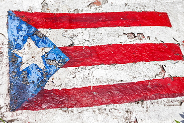 The Flag of Puerto Rico painted on a rock, Lucia Beach, Puerto Rico