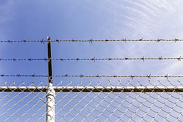Low angle view of chainlink fence