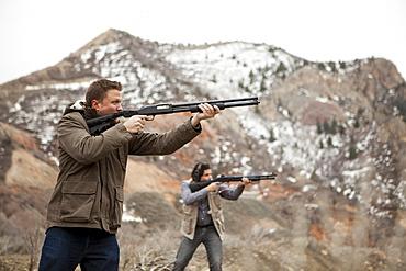 Men in mountains shooting