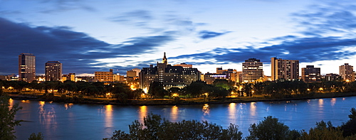 Panoramic view of city and river at dusk, Canada