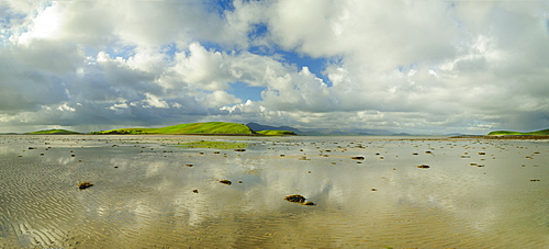 Panoramic landscape with water, clouds and hill on horizon, Clew Bay, County Mayo, Ireland