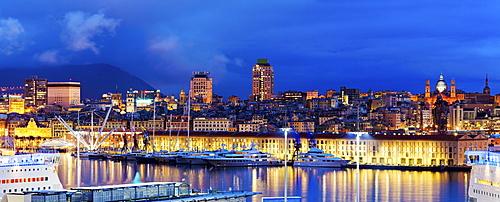 Italy, Liguria, Genoa, Panorama of harbor at dusk