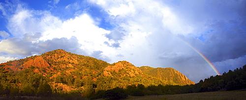 Rainbow over mountain range, USA, Western USA, Colorado