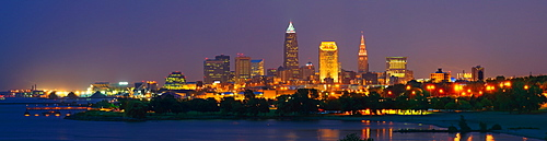 USA, Ohio, Cleveland, City skyline illuminated at dusk