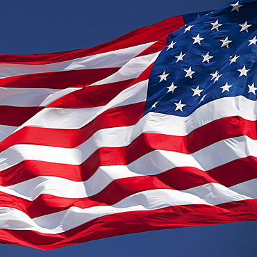 USA, South Dakota, American flag flapping against sky