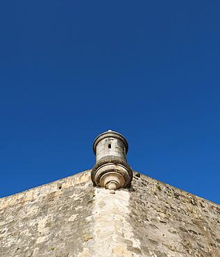 Puerto Rico, Old San Juan, section of El Morro Fortress under blue sky