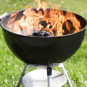 Charcoal burning in a grill