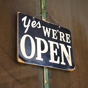 Closeup of open sign