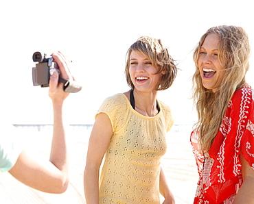 Women being filmed on beach
