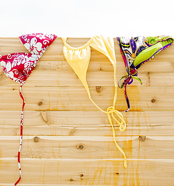 Bikinis drying on fence