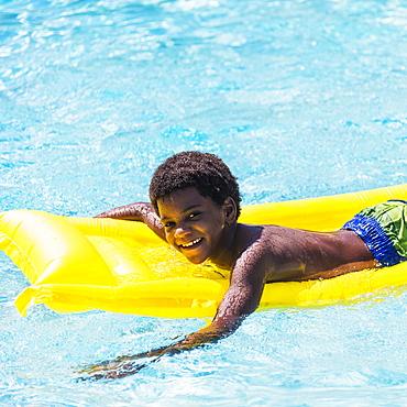 Portrait of boy ( 6-7) with pool raft