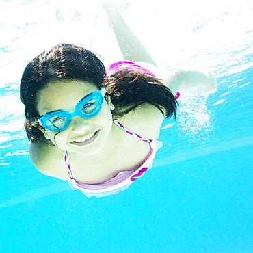 girl ( 8-9) swimming