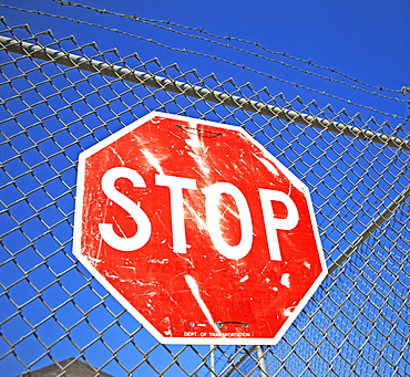 Stop sign on fence