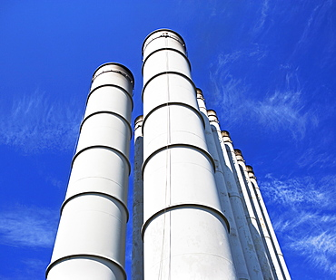 Low angle view of industrial silos