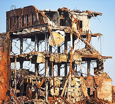 Demolished building under blue sky