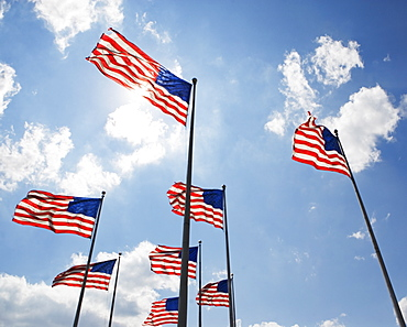 USA, New Jersey, Jackson, American flags against sky