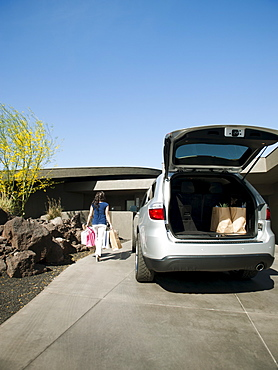 Car with open trunk with groceries, USA, Utah, St George