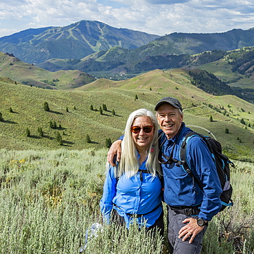 Smiling couple hiking in Sun Valley, Idaho, USA