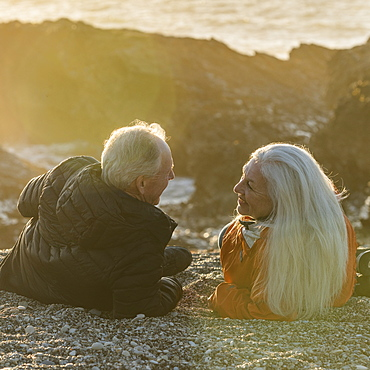 Senior couple enjoying sunset on beach