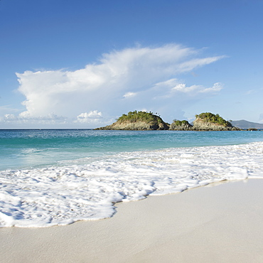 Beach with cliff in distance at Trunk Bay in St. John, Virgin Islands