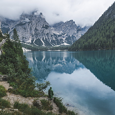 Italy, Mountains reflecting in Pragser Wildsee in Dolomites