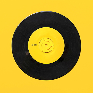 Vintage record on yellow background