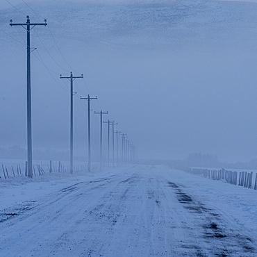 USA, Idaho, Bellevue, Empty frozen rural road in winter