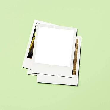 Stack of instant pictures with blank on top