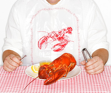 Man eating a lobster