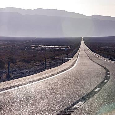 USA, Nevada, Hawthorne, Highway crossing desert landscape
