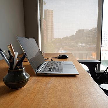 Open laptop on business desk