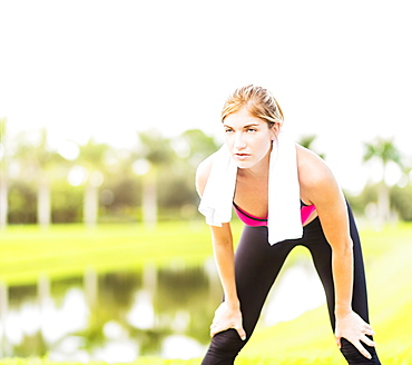 Young woman resting during work-out, Jupiter, Florida