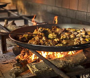 Paella on open fire stove, Valencia, Spain
