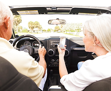 Senior couple in convertible car, Jupiter, Florida