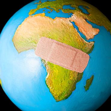 Globe with band-aid