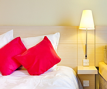 Electric lamp beside bed in luxury home