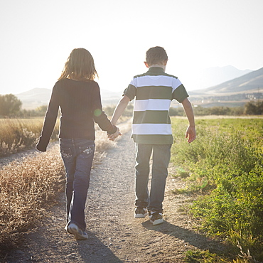 Young children walking on path