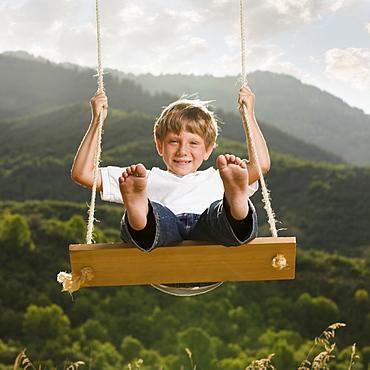 Boy swinging
