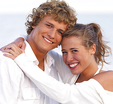 Young couple hugging on beach