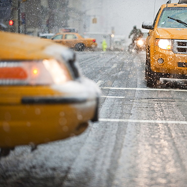 USA, New York, New York City, Close-up of yellow cab on street in snow