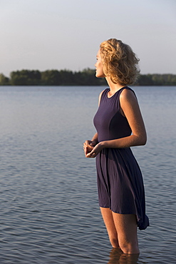 Beautiful woman standing in lake, Netherlands, Gelderland, De Rijkerswoerdse Plassen